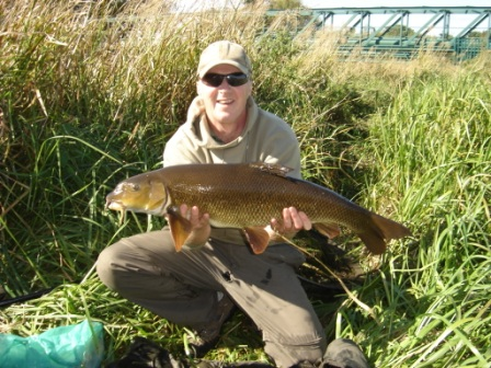 Trevor Ridley looks very happy with this 12lb 6oz barbel