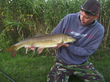 khalid Salem with a nice looking barbel weighing 9lb 9oz