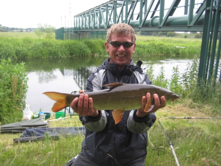 Neil Stuart with a lovely 6lb barbel from above the Pipes