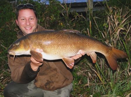 Stuart Andrews with a fantastic September barbel weighing 15lb 10oz