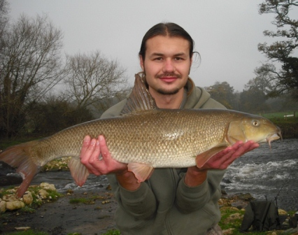 Luke with a stunning looking barbel weighing 12lb 14oz