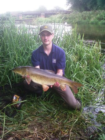 Chris Povey with a 12lb barbel from below the Cattle Dink