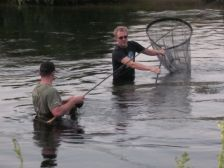 George Cornwall and Ken Thompson attempt to extract an unwilling barbel from Fiddlers