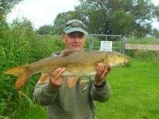 Paul Yates with an 8lb 10oz barbel landed from the top of Nelsons